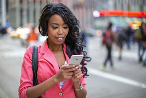 Black woman on her phone
