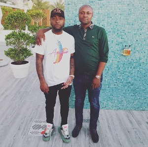 Davido with his logistics manager, Israel DMW