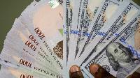 Naira falls slightly to the dollar