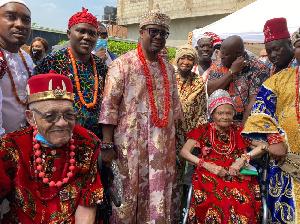 Mrs. Viola Floyd Fletcher, Hughes Van Ellis with the King of the Igbo community in Ghana
