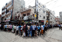 Indians queue a liquor stores after the first easing of lockdown | Reuters