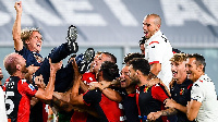 Genoa coach Davide Nicola is lifted up after the club avoided Serie A relegation  | Getty Images