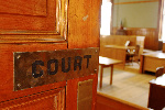 Three men in court over alleged exhumation of corpses