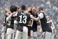 Juve players celebrating against Brescia