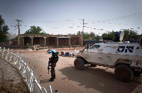 A United Nations vehicle patrols at the Independence square in Timbuktu on March 31