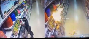 Lady caught on CCTV deliberately turning on a gas cooker at Abuja supermarket before explosion