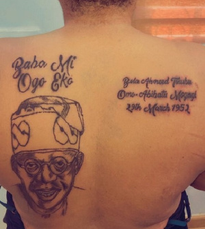 A tattoo of the former governor Tinubu on a lady's back