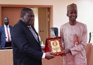 The anti-graft agency's chairman, Abdulrasheed Bawa receiving an award recently