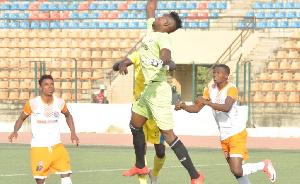 Adeyinka Adew (In green)
