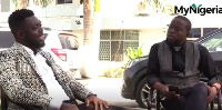 Novieku Babatunde Adeola (R) speaks to comedian and event MC, Okokobioko (L)