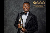 Funnybone holding his award plaque at the AMVCA