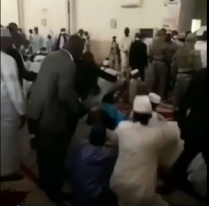 Moment Mali's President was attacked with a knife during Eid prayers