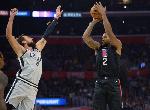 Los Angeles Clippers forward Kawhi Leonard (2) shoots against San Antonio Spurs guard Marco Belinell