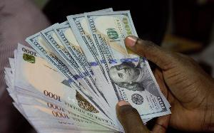 File photo: Naira and Dollar notes