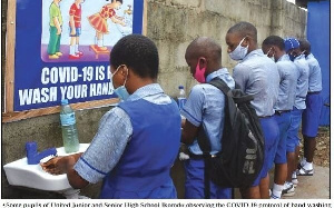 Students washing their hands