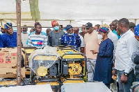 Oyetola with cabinet members examine some of the returned loot