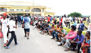 A cross-section of athletes waiting for screening