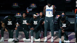 Jonathan Isaac remains standing while teammates took a knee