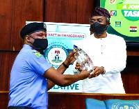 Embattled Deputy Police Commissioner, Abba Kyari receives an award from Speaker Gbajabiamila