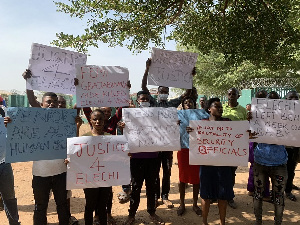 Newspaper vendors in Abuja protest the death of their colleague