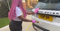 Cuppy washing her car