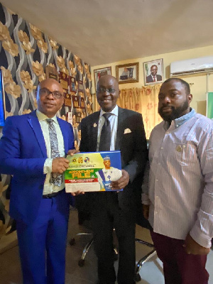 Olasunkade Azeez (L) receives appointment letter from Ademoladesoye (M) with Tolulope Sebajo present