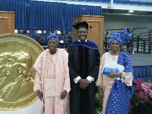 Akinwumi Adesina and his parents