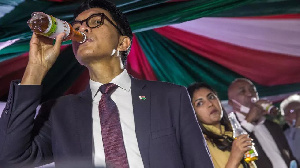 President Andry Rajoelina gulping the miracle COVID cure called
