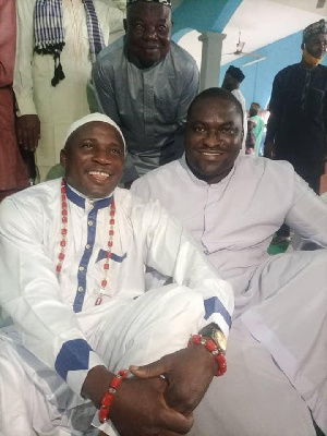 Reverend Father Peter Ayanbadejo celebrating Sallah with some Muslims at the Mosque