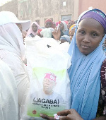 Recipients of the bags of rice were mostly women