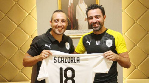 Santi Carzola and Xavi Hernandez