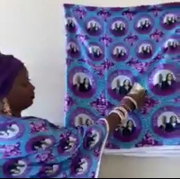 A Nigerian woman dressed in a printed attire of Joe Biden and Kamala Harris