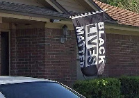 Antoine Mickle was told by the homeowners association to remove a BLM flag he hung from his house